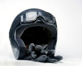 11549432-a-used-and-well-worn-motorcycle-crash-helmet-along-with-goggles-and-gloves